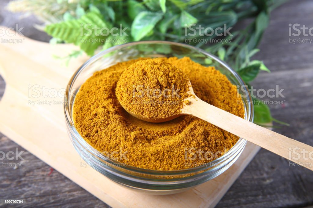 Curry powder in a bowl stock photo