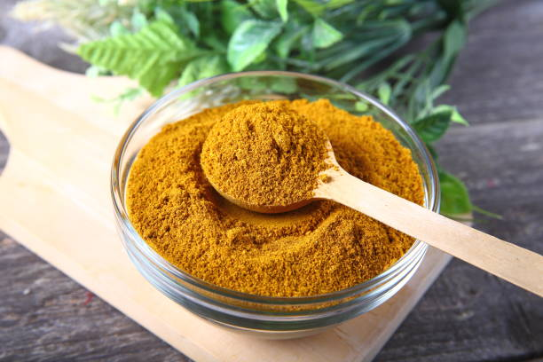 Curry powder in a bowl Curry powder in a bowl garam masala stock pictures, royalty-free photos & images