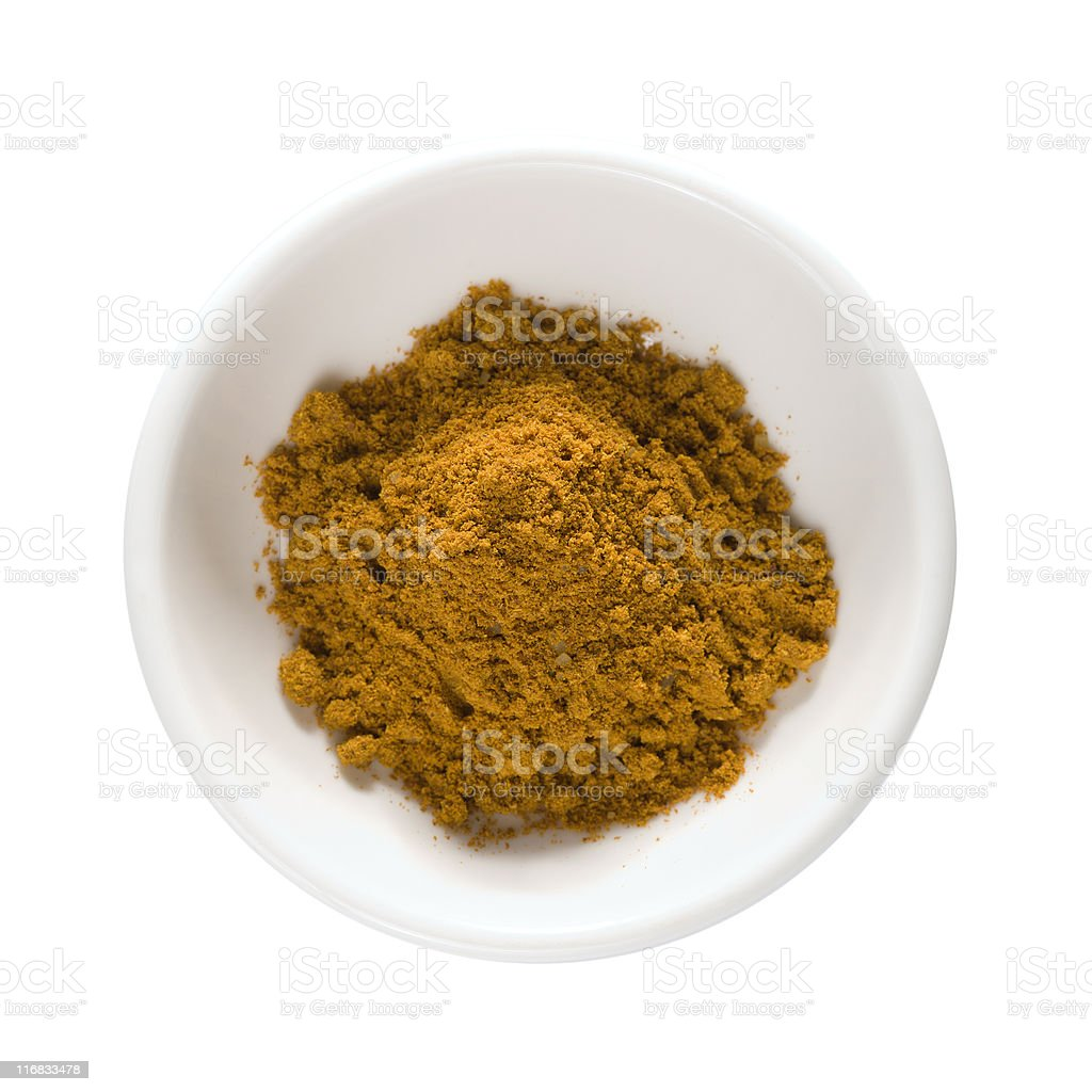 curry powder in white bowl isolated w/ clipping path royalty-free stock photo
