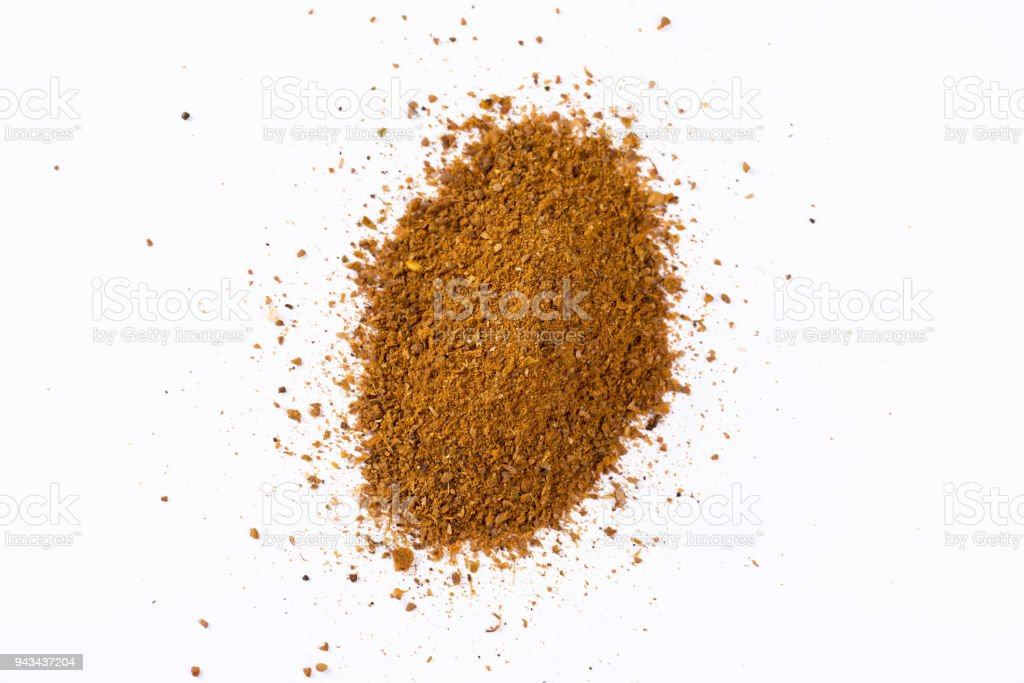 Curry powder isolated on white. Heap of curry powder isolated on white background. Aromatherapy Stock Photo