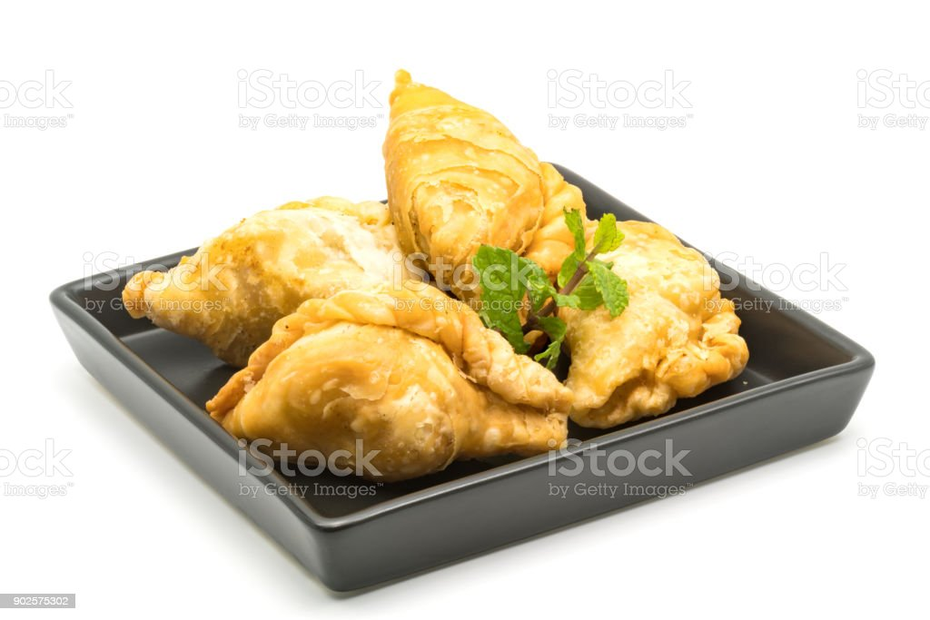Curry Puffs in a black plate stock photo