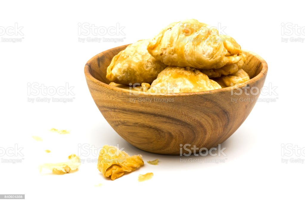 Curry Puffs in a wooden bowl stock photo