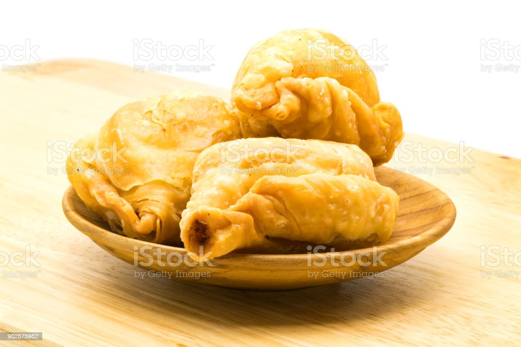 Curry Puffs in wooden plate stock photo