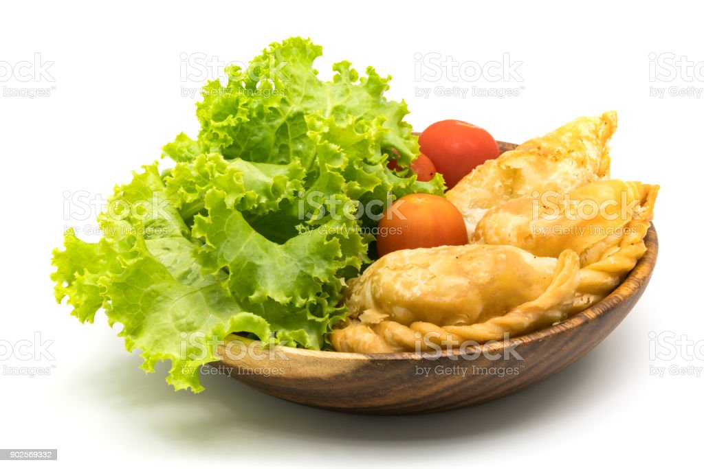 Curry Puffs, Lettuce and Tomatoes in wooden bowl stock photo