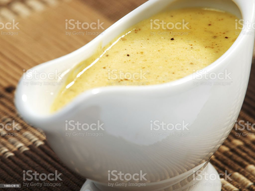 Curry sauce in white ceramic gravy boat royalty-free stock photo