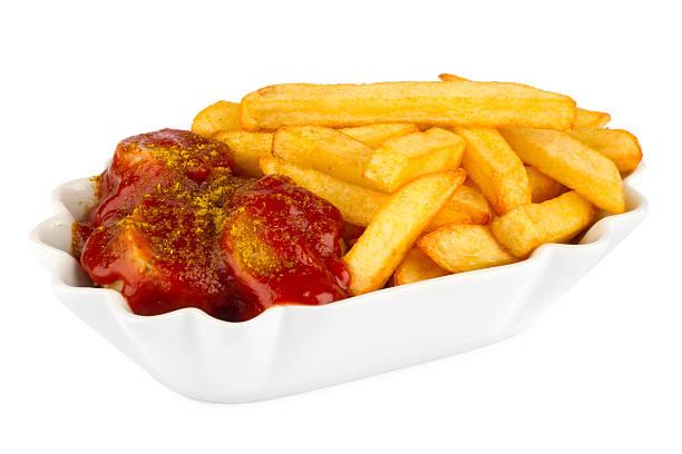 curry-würstchen mit pommes frites - currywurst stock-fotos und bilder