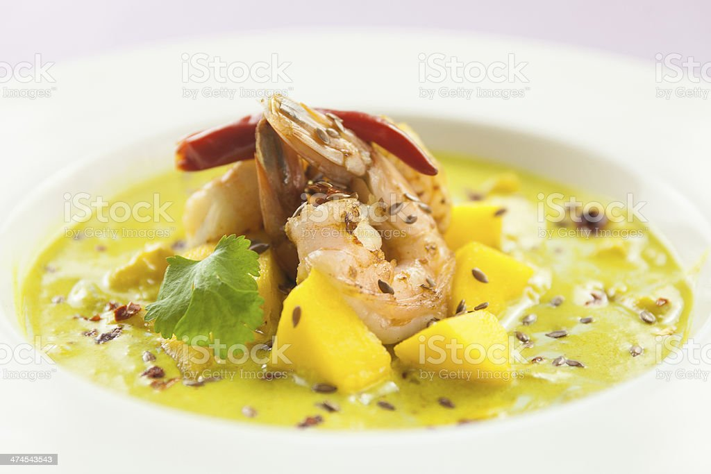 Curry soup with prawns and mango - wide royalty-free stock photo