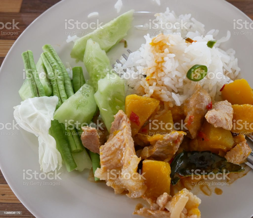Curry Stir Fried pumpkin with pork in colorful appetizing dish. Thailand People like to eat food that has a lot of advantages, such as protein and vitamins stock photo
