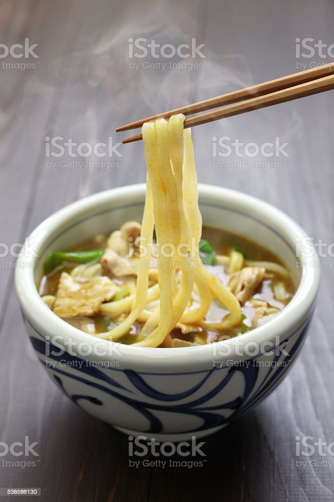 curry udon, japanese noodles soup dish stock photo