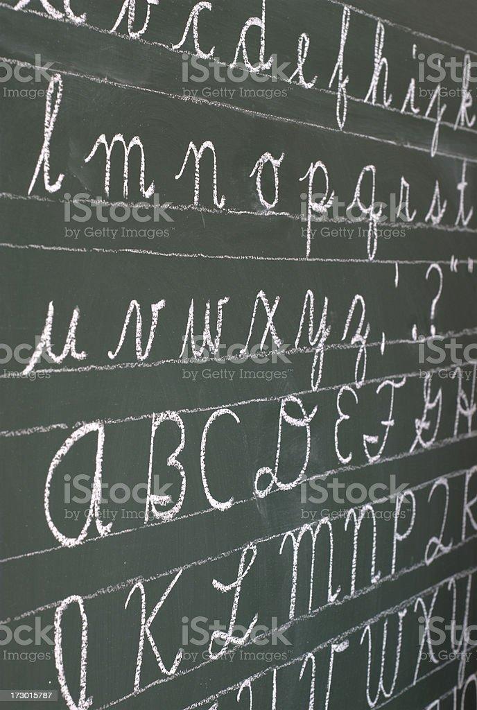 cursive alphabet stock photo