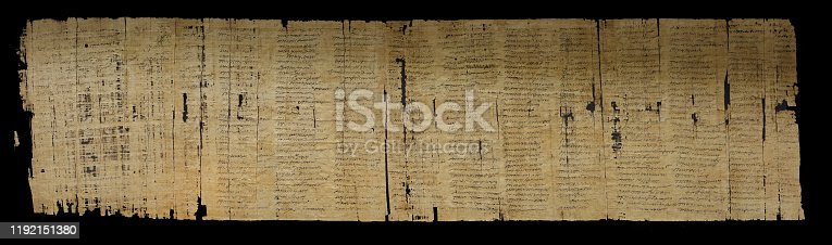 istock Cursive writing on papyrus 1192151380