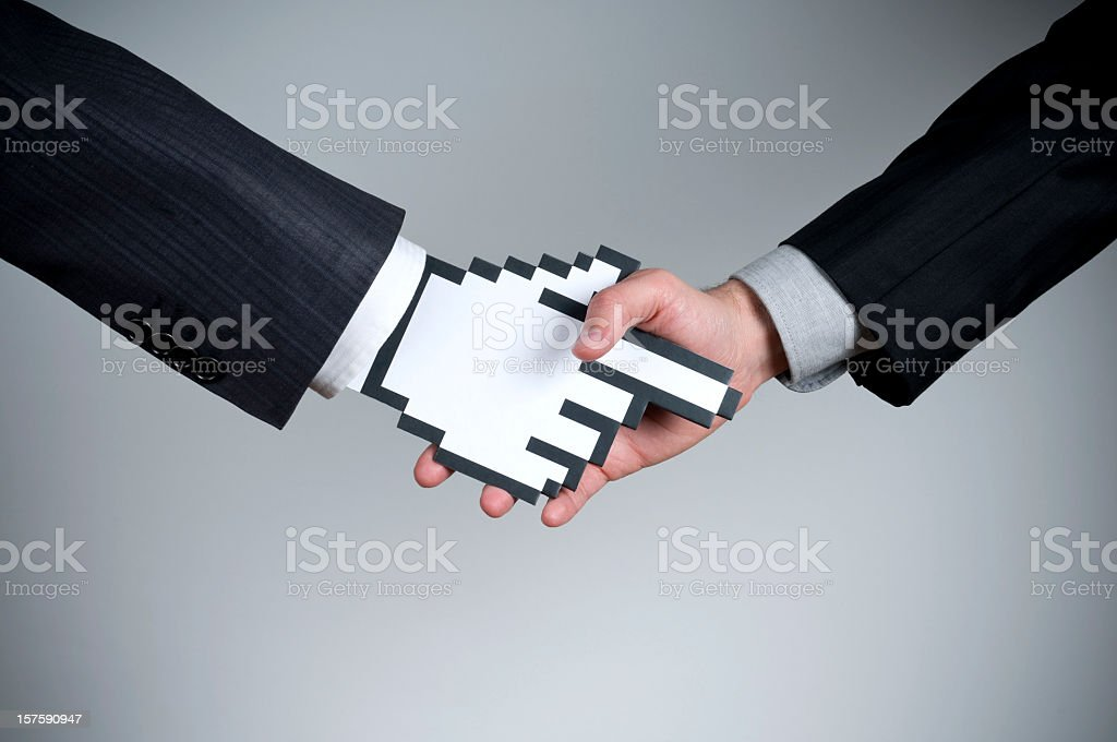 Cursorman shaking hands with a human stock photo