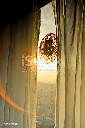 Curtain and paper-cut in sunrise background