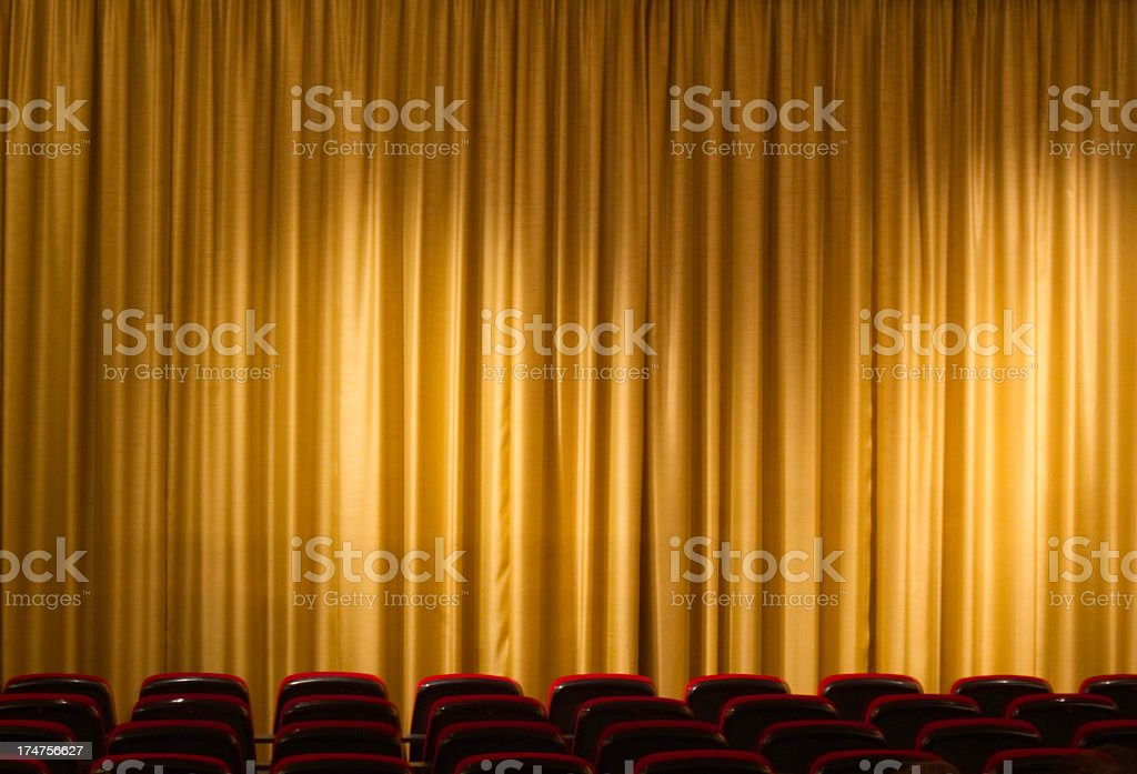 curtain from cinema or theater with seats in the background royalty-free stock photo