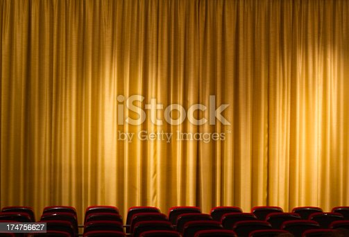 istock curtain from cinema or theater with seats in the background 174756627