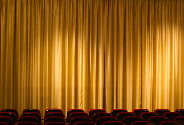 curtain from cinema or theater with seats in the background stock photo