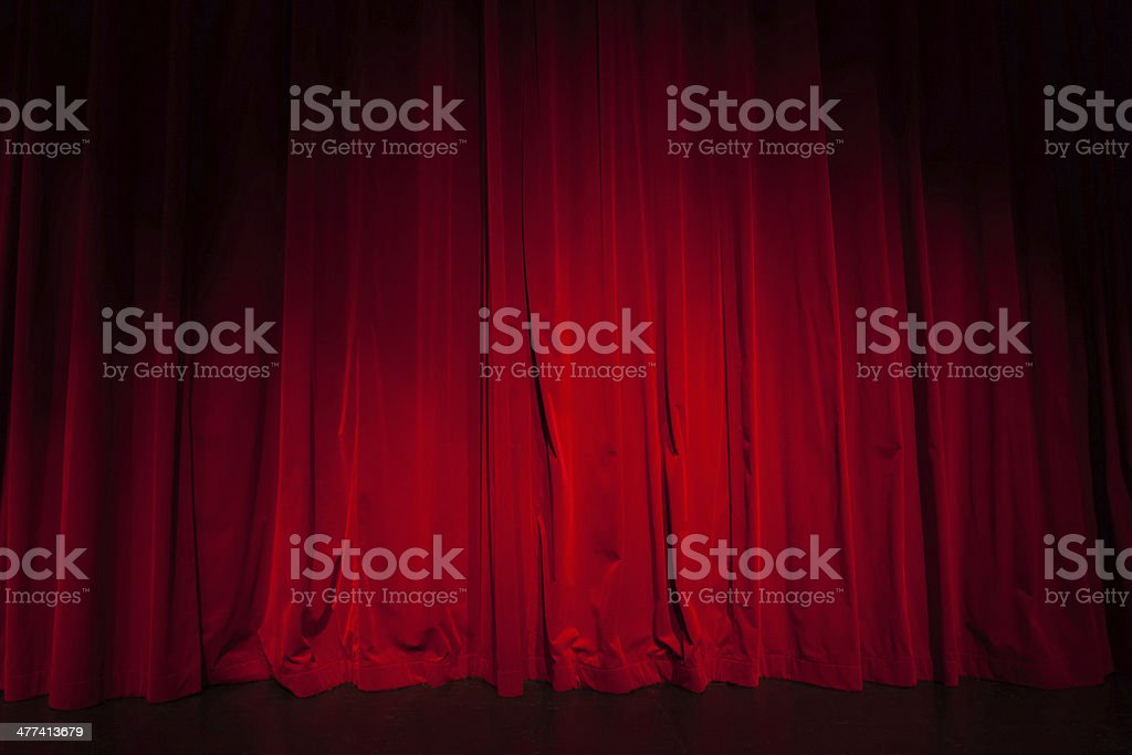 Curtain from the theater with a spotlight as background stock photo
