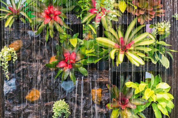curtain of interior waterfall - indoor wasserbrunnen stock-fotos und bilder