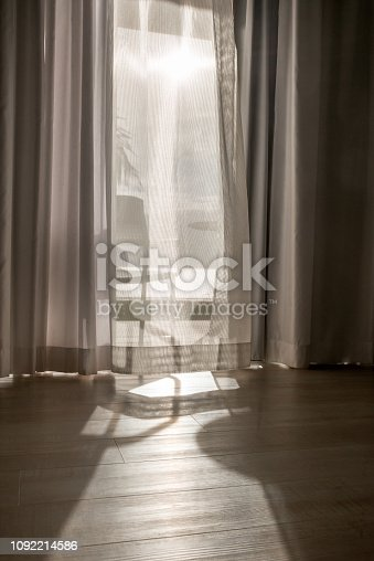 curtain on bottom in sunlight - abstract view with shadow and light