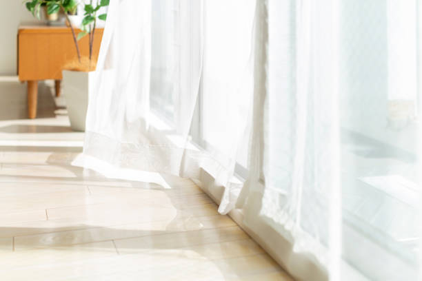 Curtain swaying in the wind stock photo
