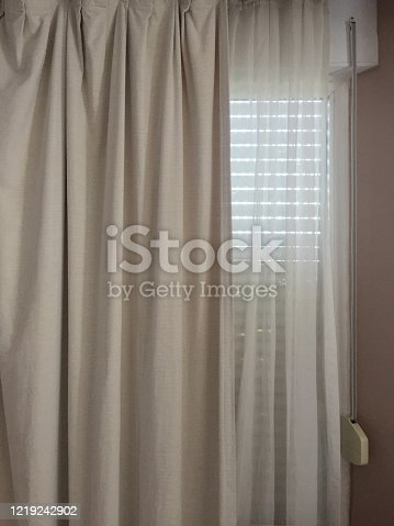 Curtains and blinds at the window