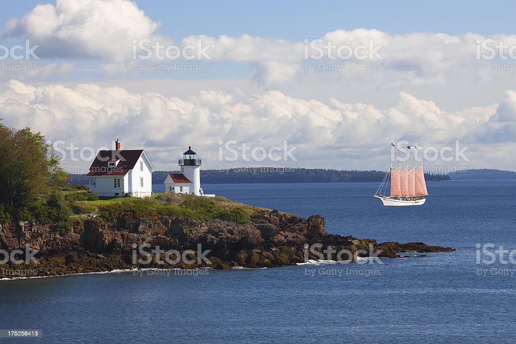 Curtis Island Lighthouse and Four-masted schooner sailboat, Camden Maine stock photo