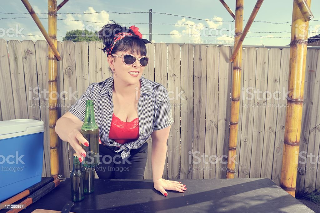 Curvaceous Rockabilly Woman Offers a Beer stock photo
