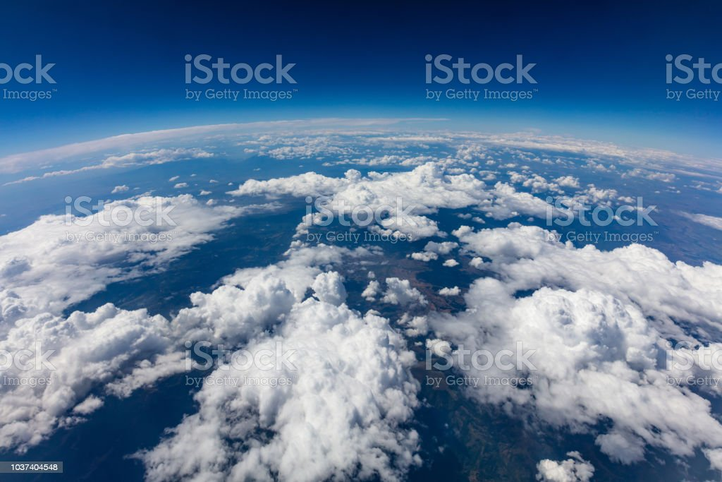 Curvature of planet earth. Aerial shot. Blue sky and clouds stock photo