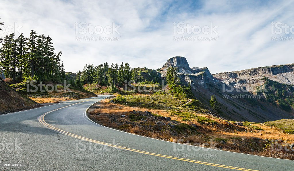 curve and slope asphalt road on the mountain stock photo