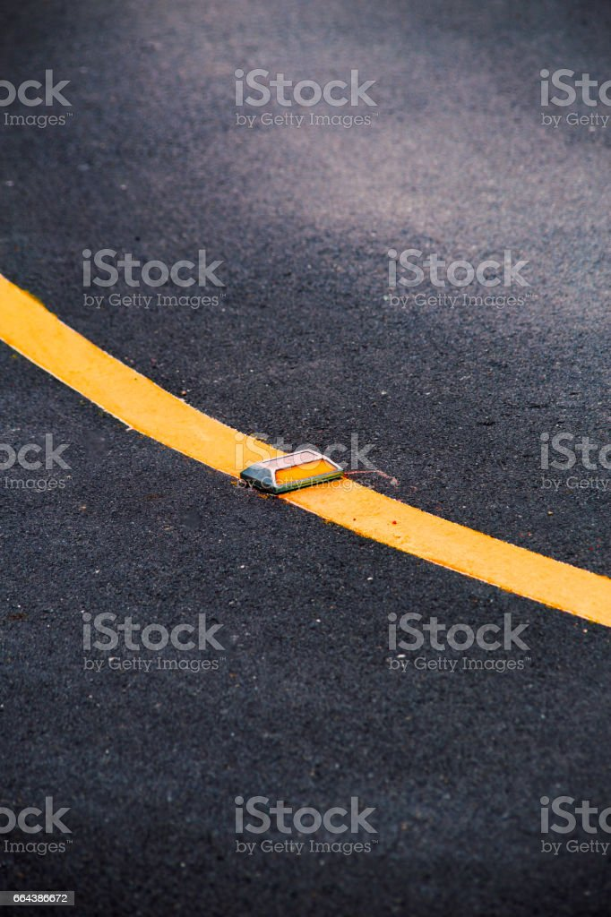 Curve Asphalt road with yellow reflector line. stock photo