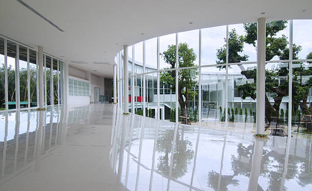 Curve glass wall in the modern building Curve glass wall in the modern building background courtyard stock pictures, royalty-free photos & images