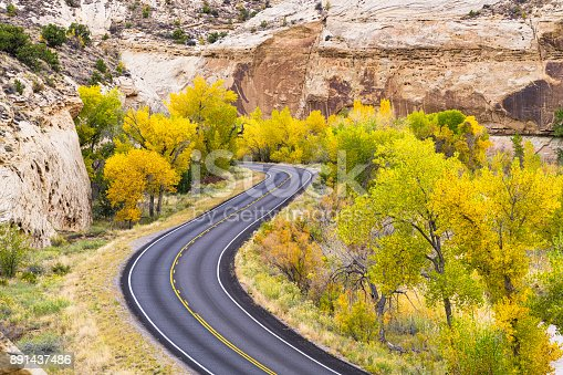 Capitol Reef Fall Colors and Red Rock Canyons - Scenic view with peak fall colors in Capitol Reef National Park, Utah USA.