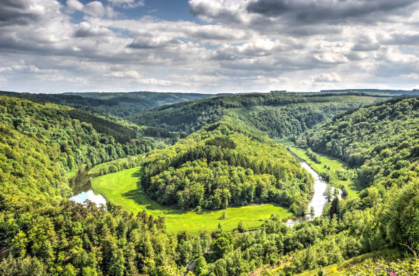 Curve in the river Semois View from the surrounding hills towards a curve in the river Semois in the Ardennes near Bouillon, Belgium belgium stock pictures, royalty-free photos & images