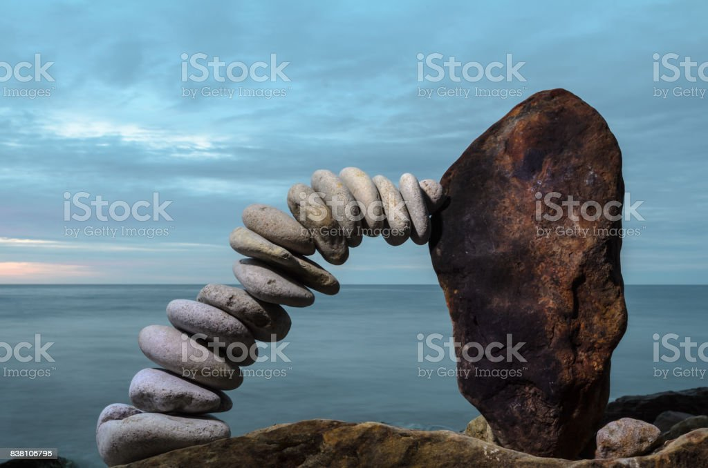 Curve of pebbles stock photo