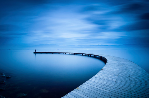 Curve of the Jetty and Man
