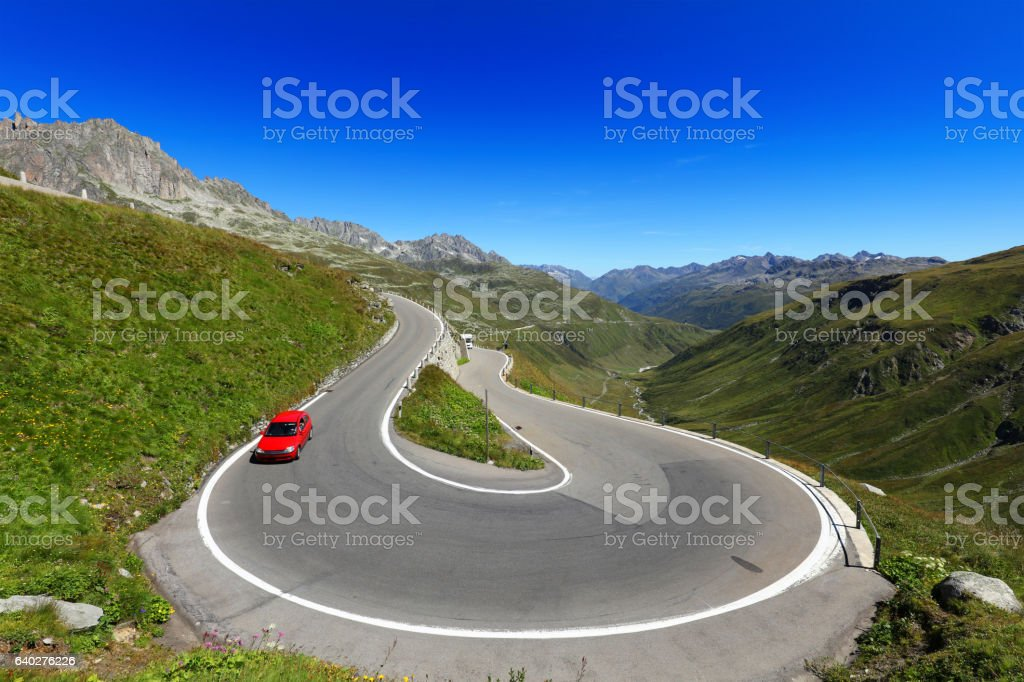 Curve on a Mountain Road at Furka Pass Switzerland stock photo