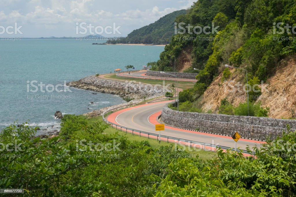 Curve road beside the ocean stock photo