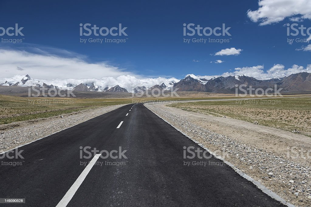 Curve road with Himalayas range stock photo