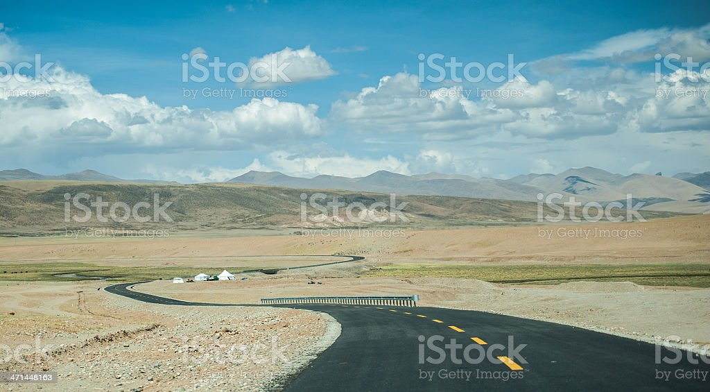 Curve road with snow mountain stock photo