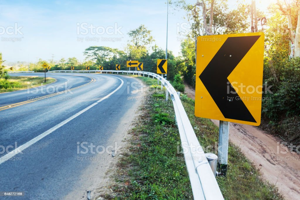 Curve warning sign on the road stock photo