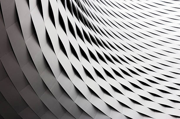 Curved and rippled metal roof construction stock photo