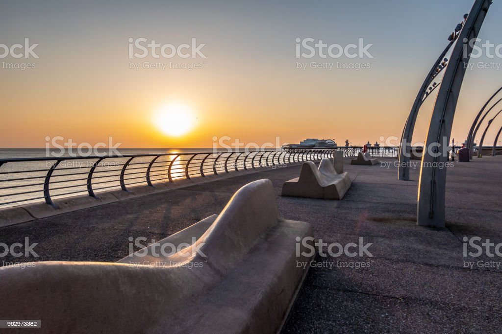 Curved benches by the sea in Blackpool, Lancashire stock photo
