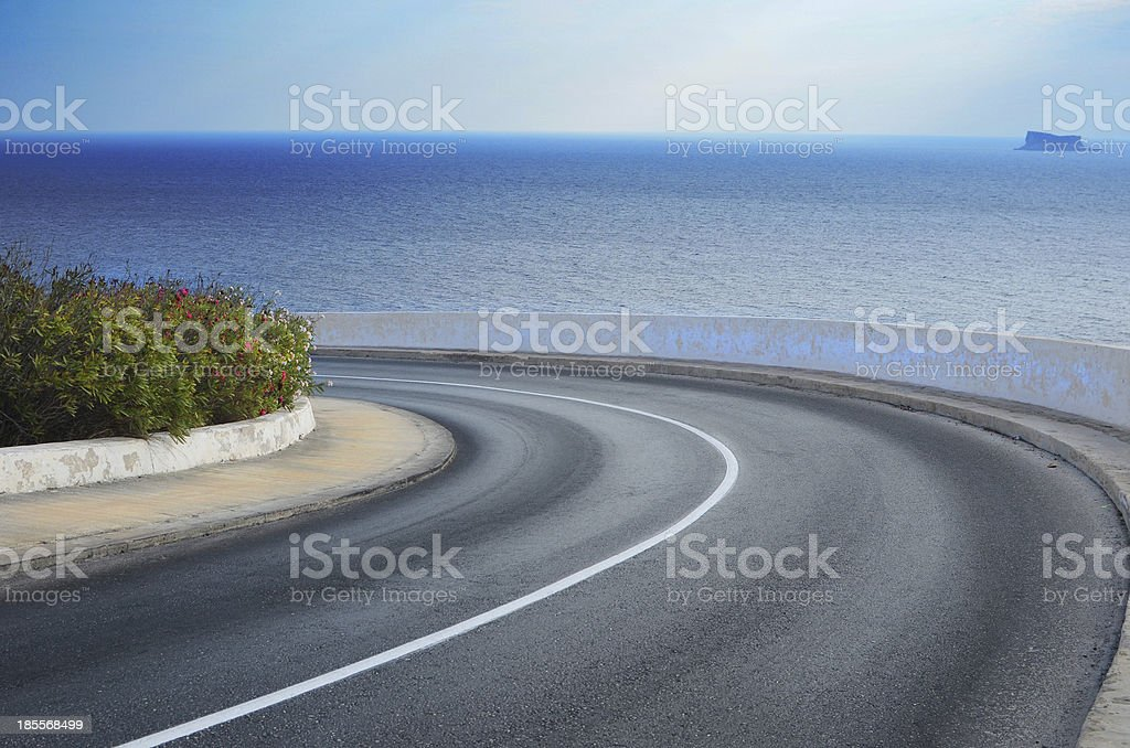 Curved coastal road in Malta stock photo