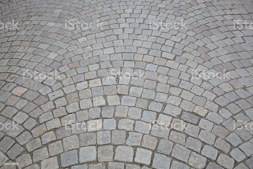 Curved Cobblestone Road Background royalty-free stock photo