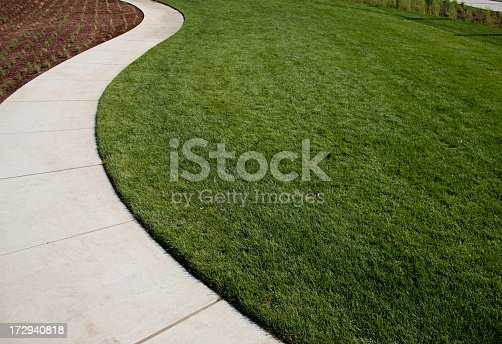 Lawn, garden, and curved sidewalk around grass. XXL.