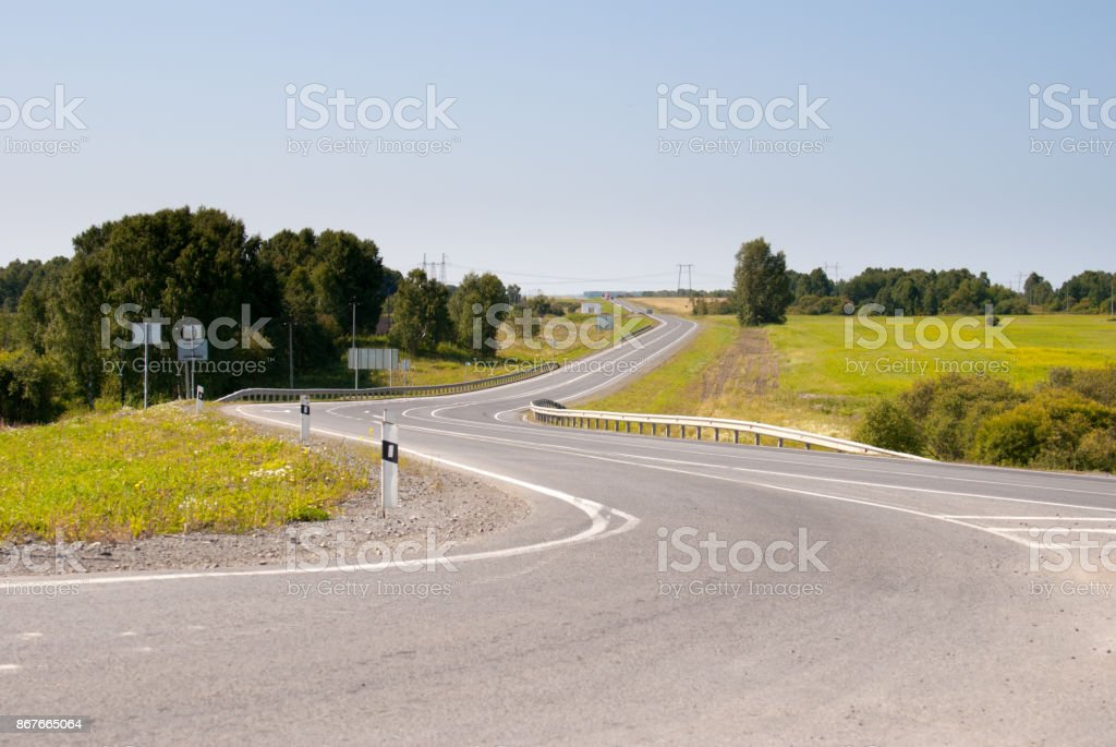 curved country asphalt road stock photo