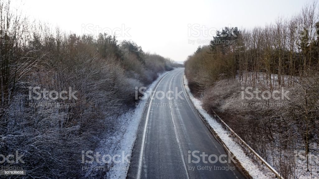 Road curving out of sight through the Nothamptonshire Countryside on...