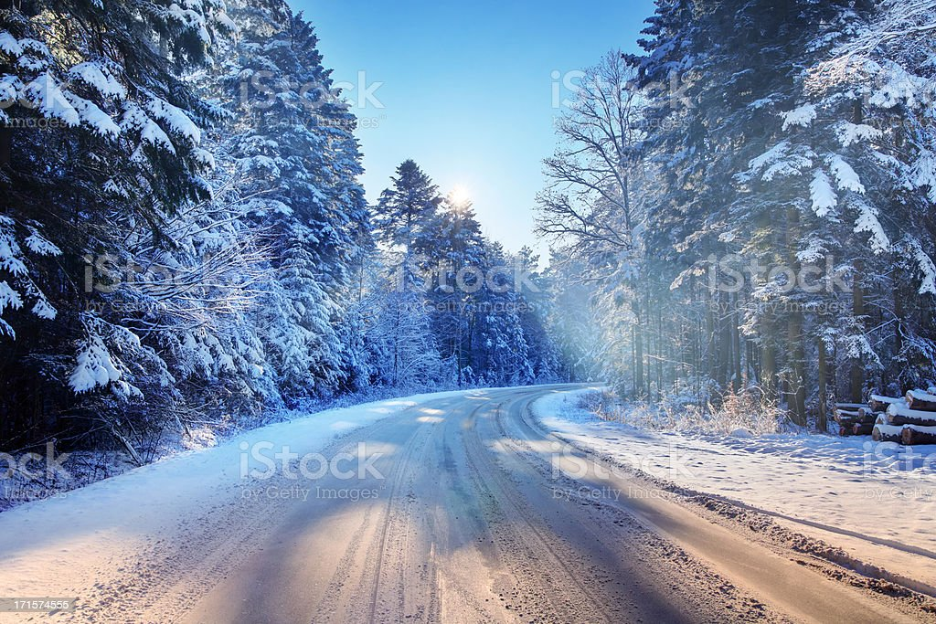 Curved country Road - Snowy Winter - Royalty-free Asphalt Stock Photo