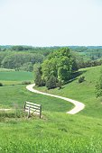 """""""S"""" shaped driveway to the farm in the country."""