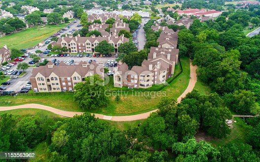 istock Curved Hiked and Bike Trail around Modern Condo Apartment Complex in Austin Texas 1153563962